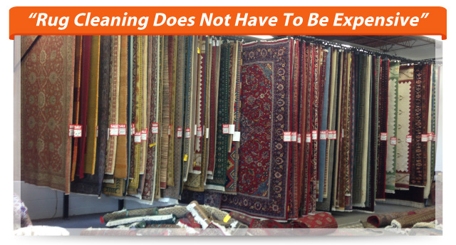 """Rug Cleaning Does Not Have To Be Expensive"" - Rug display"